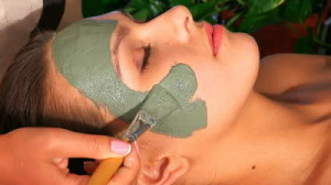 stock-footage-woman-with-clay-facial-mask-in-beauty-spa